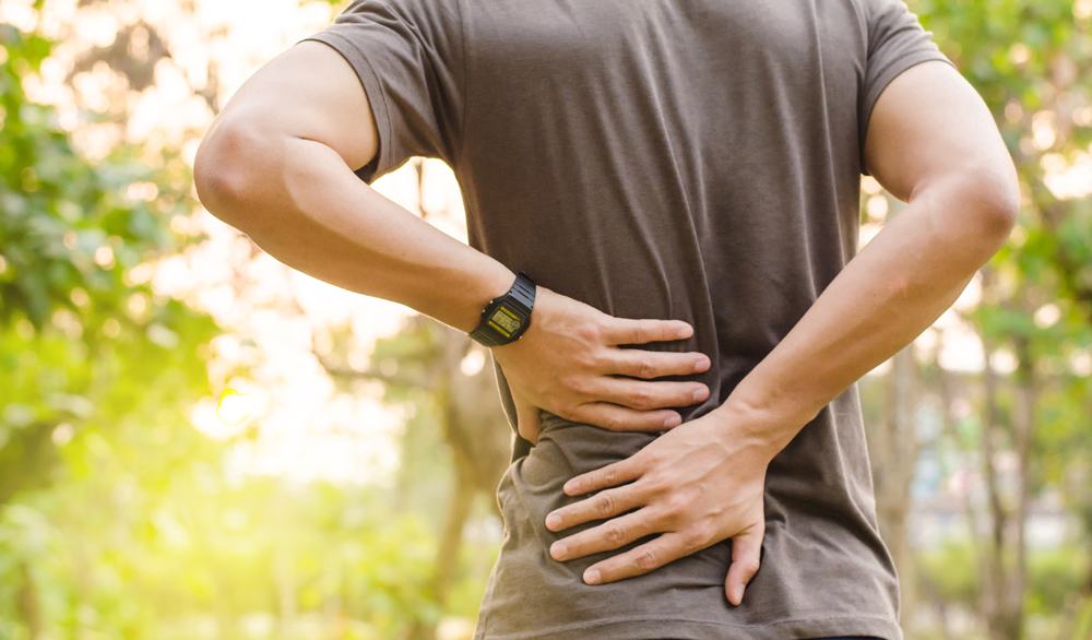 Man with back pain needs chiropractic care.