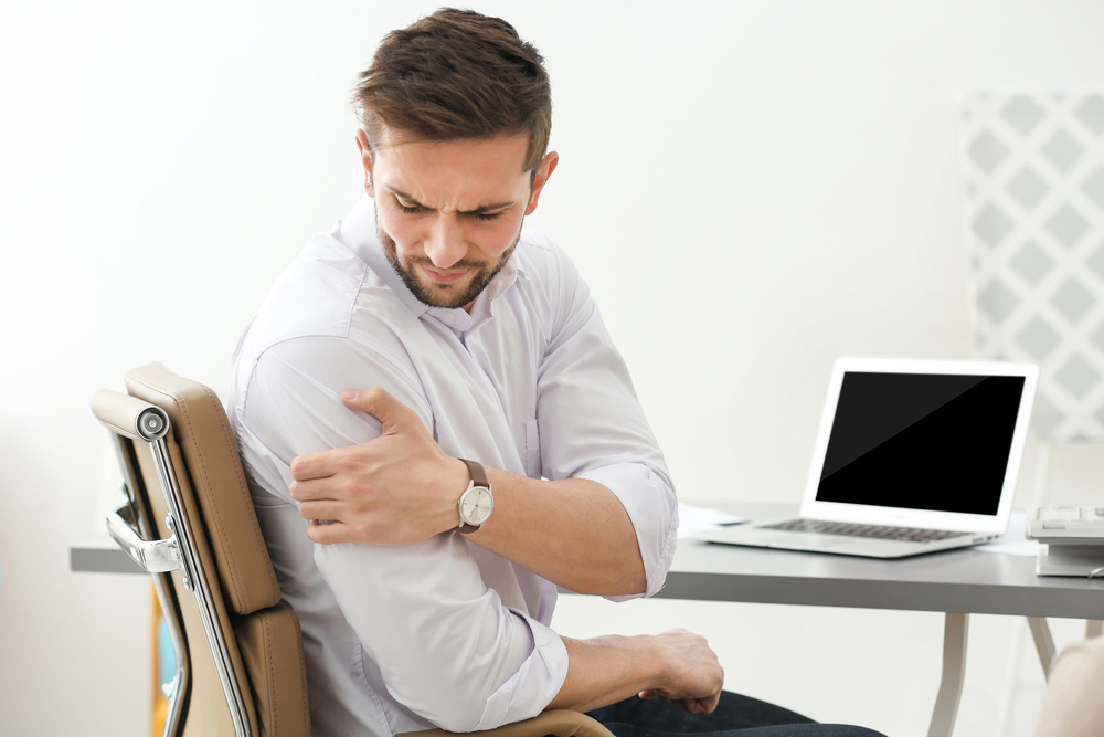 Man with shoulder pain needs chiropractic care in Manhattan, KS.